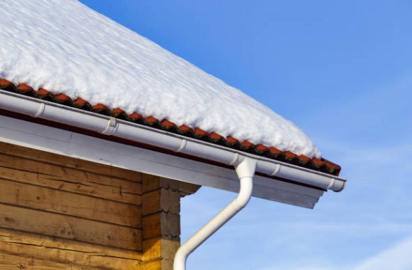 Snow pile on a metal roof